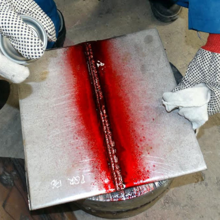 report on ndt dye penetrant Non-destructive testing/inspection/evaluation techniques such as dye penetration, magnetic dye penetrant examination (as2062) uses a variety of materials (as2565) which are brightly coloured however, it also collects on laps, machining marks, corners and other sites hence a report stating.